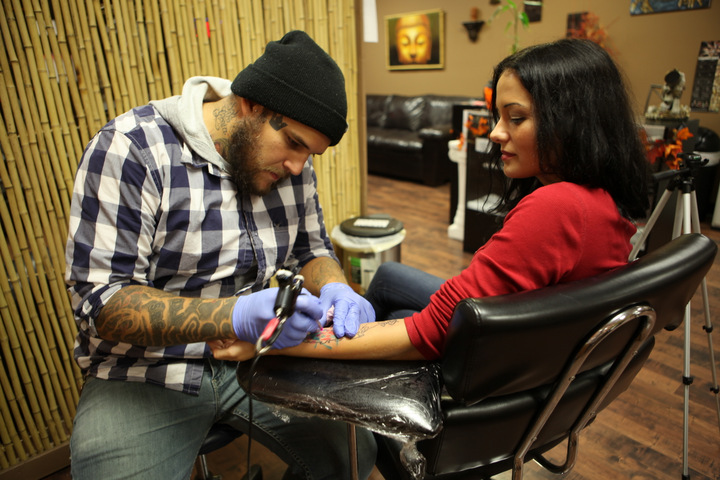 getting travel tattoo at live loud studios cincinnati ohio