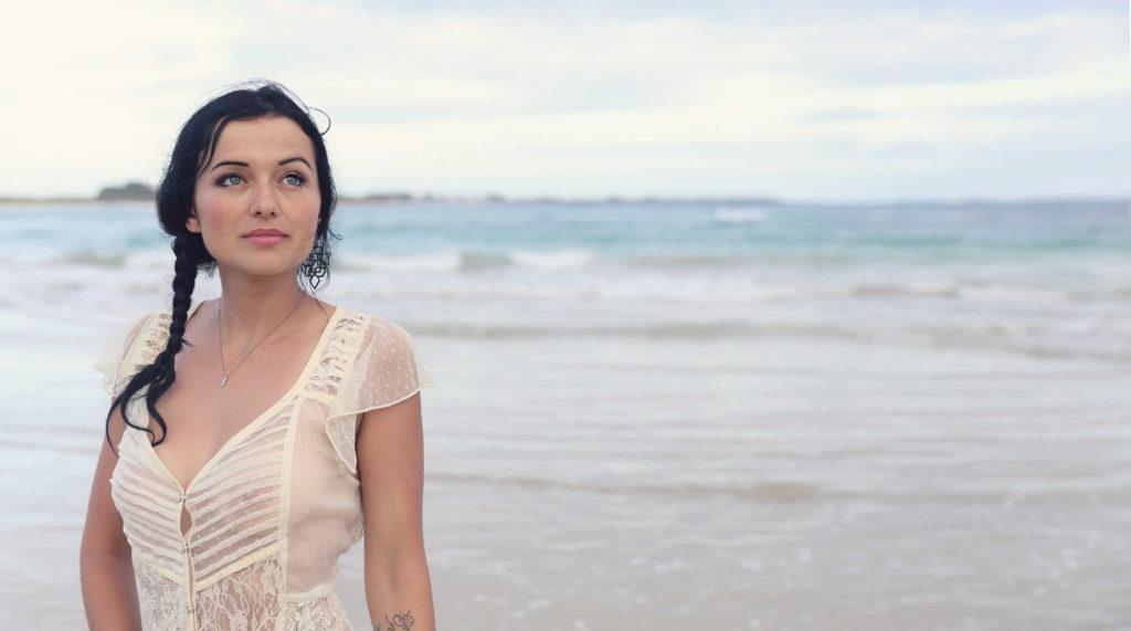 girl facing camera on beach